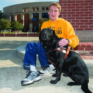 Alex Hubbard, blind Sidelines Editor, and his seeing eye dog, Lark