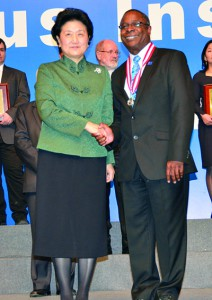 China's highest-ranking education leader, Vice Premier Liu Yandong, presented the Confucius Institute's Individual Performance Excellence Award to MTSU President Sidney A. McPhee during the eighth annual Global Confucius Institutes Conference in Beijing on Saturday. (MTSU photo)
