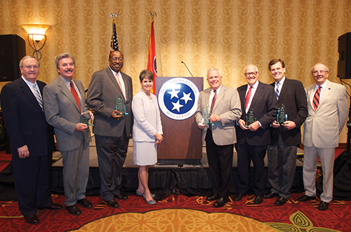 From left: Phil Cox, who represented Luther Masingill; Bob Johnson; Otis Sanford; event emcee Demetria Kalodinos; Sam Venable; Alex S. Jones; Joe Birch; and Hooper Penuel, the hall's cofounder. (MTSU photo)