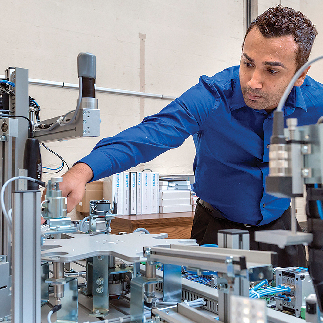 Graduate student Sam Chatterjee in the Mechatronics lab in Voorhies Engineering Technology Building.