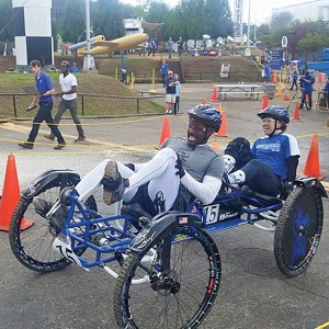 MTSU lunar rover drivers Zack Hill, left, and Nichole Wanamaker pedal toward the finish line recently at the NASA Human Exploration Rover Challenge in Huntsville, Alabama. (Submitted photo)