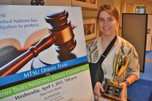 Leigh Stanfield, a junior communications studies major from Soddy Daisy, Tennessee, holds the trophy for the novice division title she won during the MTSU Debate Team's participation in the International Public Debate Association's National Championship Tournament and Convention held March 27-29 at Boise State University.