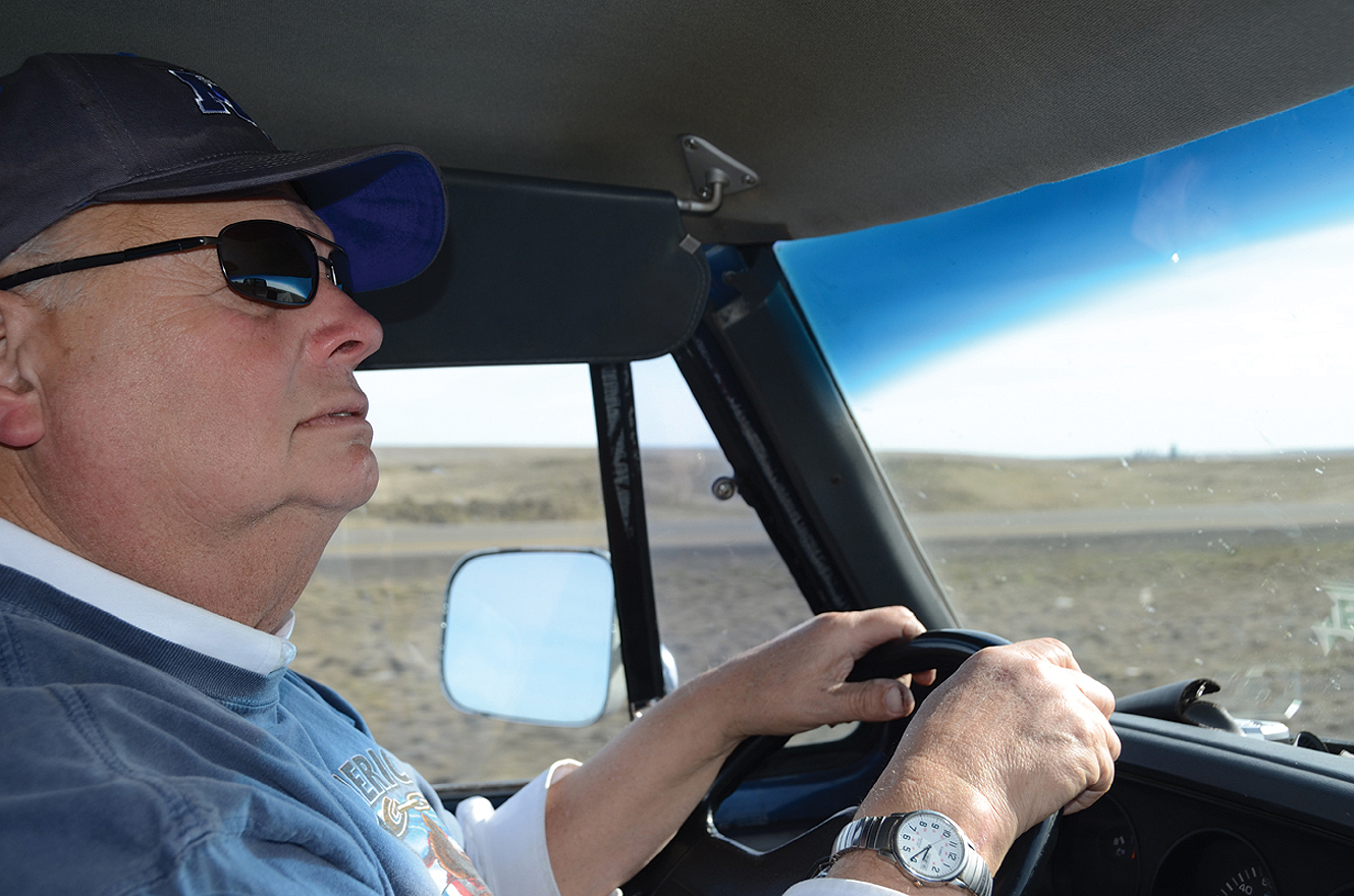 "MTSU professor Cliff Ricketts checks his rear-view mirror while driving on I-90 March 10. In the ""Southern Fried Fuel"" trip using waste chicken fat and used cooking oil from MTSU dining facilities, he and his team completed a successful 3,500-mile trip from Key West, Florida, to Seattle, Washington, March 10. (MTSU photo by News and Media Relations)"