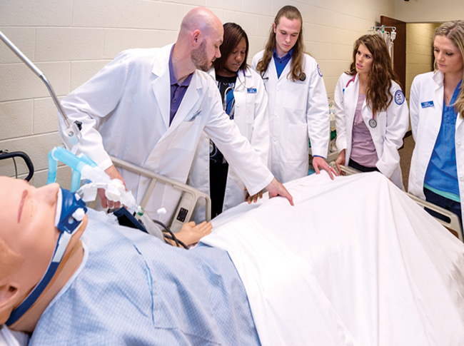 In this spring 2014 photo, from left, MTSU graduate student Todd Vickrey works in a nursing lab with nursing students LaQwell Cheart, Jonathan Holland, Lauren Sliger, and Hanna Lovelady. (MTSU file photo by Andy Heidt)