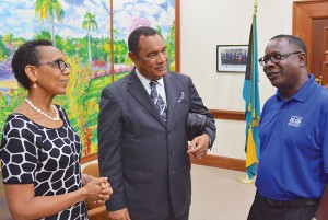 MTSU President Sidney A. McPhee, right, meets with the Commonwealth of the Bahamas Prime Minister Perry G. Christie, center, and Allyson Maynard Gibson, left, attorney general and minister of legal affairs of the Bahamas, just before the Blue Raiders men's basketball team played Thursday, Aug. 13, 2015, in the first of three preseason exhibition games at the Commonwealth's national gymnasium. (MTSU photo)
