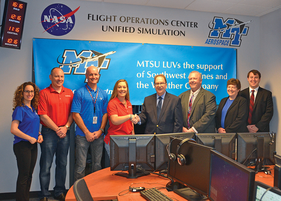 MTSU offers a thank-you to Southwest Airlines and The Weather Company for a sizable gift in the form of WSI Fusion weather software that will be utilized in the aerospace department's NASA FOCUS Lab in the Business and Aerospace Building. From left are MTSU associate professor Andrea Georgiou; Southwest employees and MTSU alumni Larry Schadle, Capt. Ken Hamilton and Whitney Dix; and MTSU Provost Brad Bartel, College of Basic and Applied Sciences Dean Bud Fischer, interim aerospace chair Wendy Beckman and MTSU senior Evan Lester. (MTSU photo by Randy Weiler)
