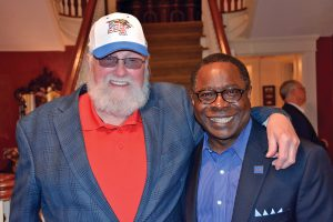 MTSU President Sidney A. McPhee gave Charlie Daniels a special veterans-themed MTSU hat after announcing that the Veterans and Military Family Center will be named for the country music icon and his wife, Hazel. (MTSU photo by Andrew Oppmann)