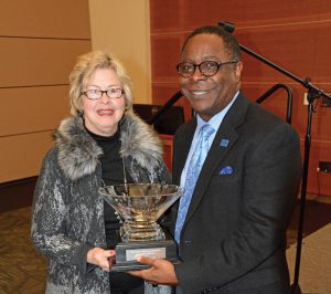 Connie J. Smith, director of Advanc-ED Tennessee, left, presents MTSU President Sidney A. McPhee on Tuesday, March 1, with the organization's 2016 Leadership in Education Award for his efforts to support STEM (science, technology, engineering and mathematics) learning in primary, secondary and higher education. McPhee received the honor as Advanc-ED Tennessee wrapped up a two-day conference on the MTSU campus Tuesday that attracted hundreds of public, private and parochial educators, school board members, superintendents and principals to learn and reflect on ways to best extend STEM education. (MTSU Photo)