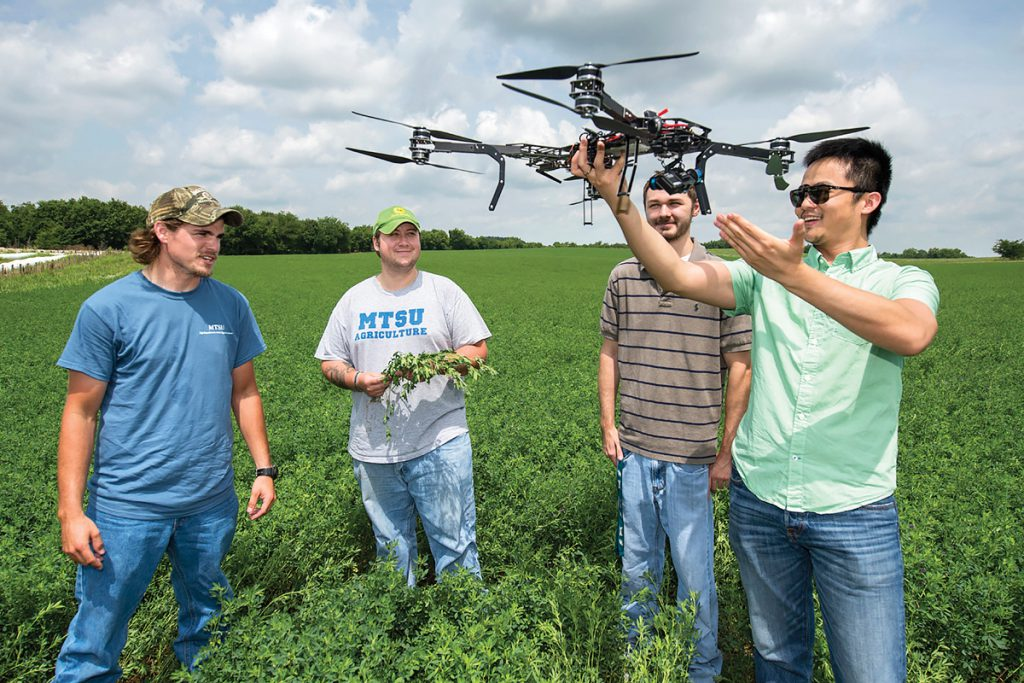 MTSU Farm units including Swine Unit, Beef Unit, and Crops. Song Cui, Aerospace faculty, left, talks about UAV use at the Guy James Farm with Trevor Hasty, left, and Daniel Troup.