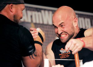 "Pro arm wrestler Jason Gulley of Murfreesboro takes on Jason ""Stump"" Burton of Georgia at the Flex Lewis Classic arm wrestling tournament at Embassy Suites Saturday, June 23, 2012."