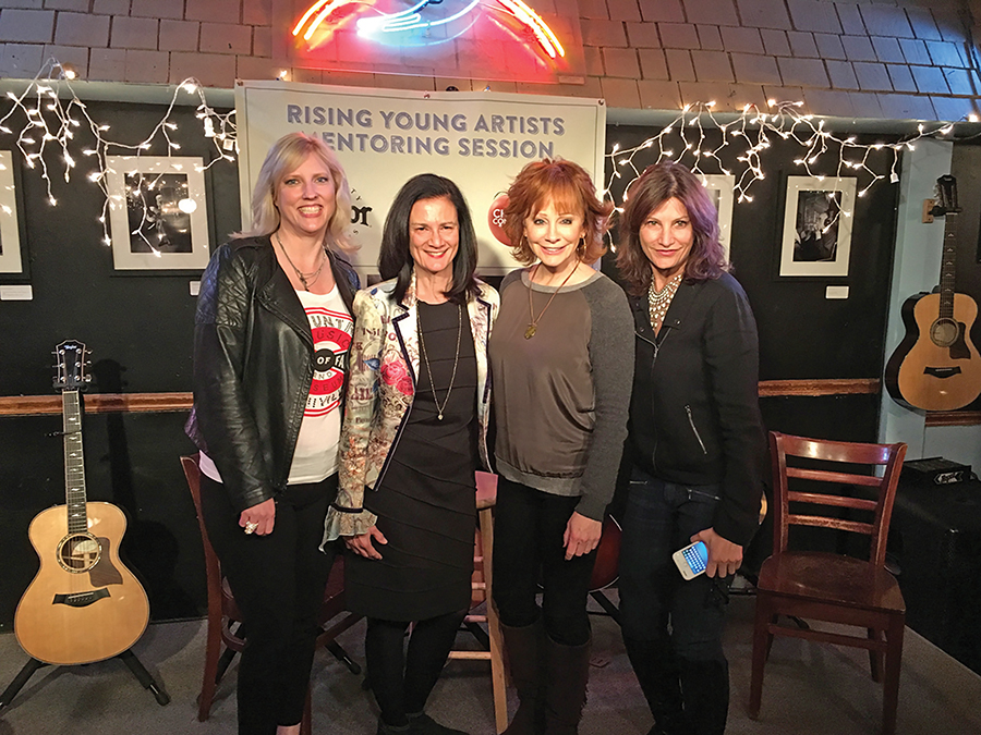 The Change the Conversation group recently launched its mentoring sessions for young artists at the Bluebird Café in Nashville, Tennessee. Pictured, from left, are Beverly Keel, chair of MTSU's Department of Recording Industry and co-founder of Change the Conversation; Leslie Fram, CMT senior vice president and Change the Conversation co-founder; country music legend and special guest Reba McEntire; and Tracy Gershon, Rounder Records Group's vice president of A&R and Change the Conversation co-founder. (Photo courtesy of Justin McIntosh)