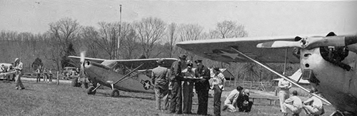 This photo was published in the 1952 Midlander Yearbook. The text from the yearbook read: The Middle Tennessee State College Squadron of the Civil Air Patrol was organized in July 1948, under the supervision of Maj. Elmour Meriwether, Commanding Officer, and Capt. Miller Lanier, Executive Officer. Approximately 75 percent of the members of the Squadron were pilots trained at the College Airport. The organization received statewide recognition for training maneuvers they carried out, especially in search and rescue missions and patrolling and locating forest fires. A well-equipped ground school provided opportunity for instruction in other areas of the CAP work, such as communications, first aid, cadet training and supply. (MTSU photo)