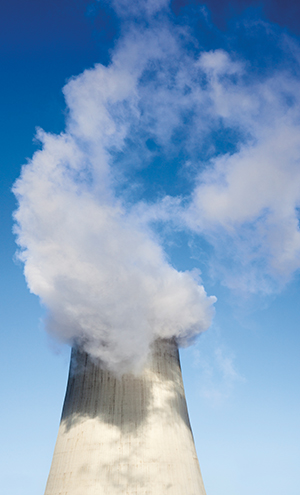 Cooling tower of the power plant in Kyiv (Ukraine) with water vapor over it.