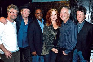 Grammy-winning artist Bonnie Raitt (center) poses with Middle Tennessee State University President Sidney A. McPhee (left of Raitt) and Ken Paulson, dean of the College of Mass Communication, before the Americana Music Festival's pre-Grammy salute to Phil Everly at the Troubadour club on Saturday, Jan. 25, in West Hollywood. Also pictured is Jed Hilly, Americana's executive director (far left), singer-songwriter Rodney Crowell (second from left) and singer-songwriter Joe Henry (far right). (MTSU photo by Andrew Oppmann)