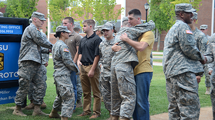 Current MTSU ROTC cadets offer congratulations to four of nine newly contracted cadets Aug. 22 during the ROTC contracting oath ceremony outside Forrest Hall.